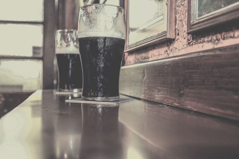 Two glasses of dark stout beer on a bar at an Irish pub in Dubllin Alcohol Bar Beer Close-up Dark Day Drink Drink Up Dublin Froth Glass Guiness Indoors  Ireland Irish Pub No People Pub Stout Table Two