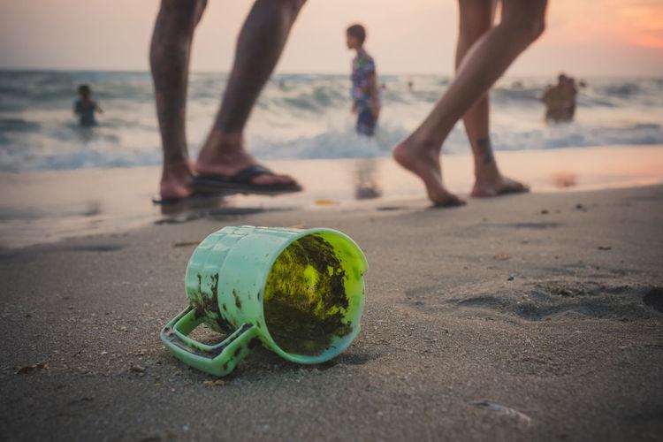 Broken Mug At Beach During Sunset