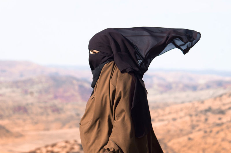 Side View Of Woman In Hijab Against Sky