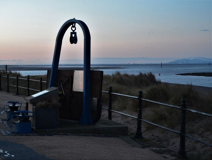 Fleetwood monument / history with views across the bay at sunset towards Barrow in Furness (Lake District). Sky Water Sea Railing Scenics - Nature Beauty In Nature Nature Tranquil Scene Horizon Horizon Over Water Tranquility Land Beach Sunset No People Outdoors Barrier Architecture Day