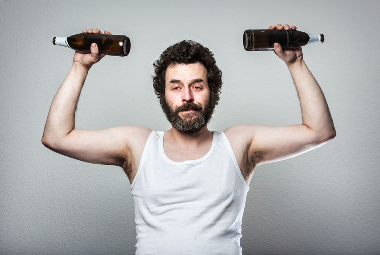 Funny Series of a Bearded Slob of a man, with beer belly, trying to do Sports with his beer Bottles :D Beer Fed Up FedUp Funny Humor Man Tanktop Adult Alcholic  Alcohol Beard Bearded Beer Belly Deplorable Holding Lazy One Person People Portrait Slob Sport Tank Top Tired Weight Lifting Weights