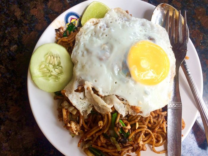 fried noodles with fried eggs on top for lunch Lunch Malaysian Food And Drink Plate Ready-to-eat Egg Food And Drink Food Freshness No People High Angle View Fried Egg Serving Size Indoors  Healthy Eating Day Close-up