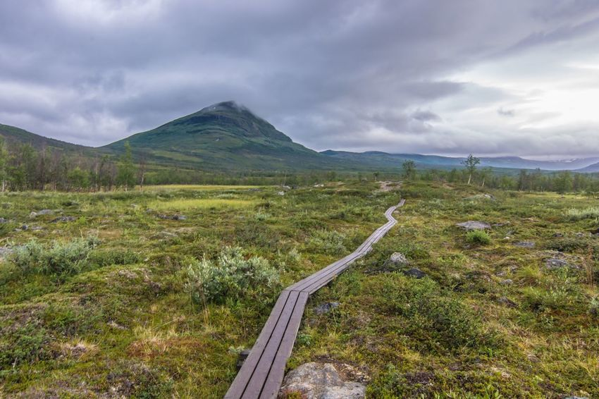 Sky Mountain Landscape The Way Forward Scenics Nature Beauty In Nature Cloud - Sky Outdoors Countryside Tranquil Scene Road Day Grass No People Fjallravenclassic Hiking Lappland Sweden Abisko