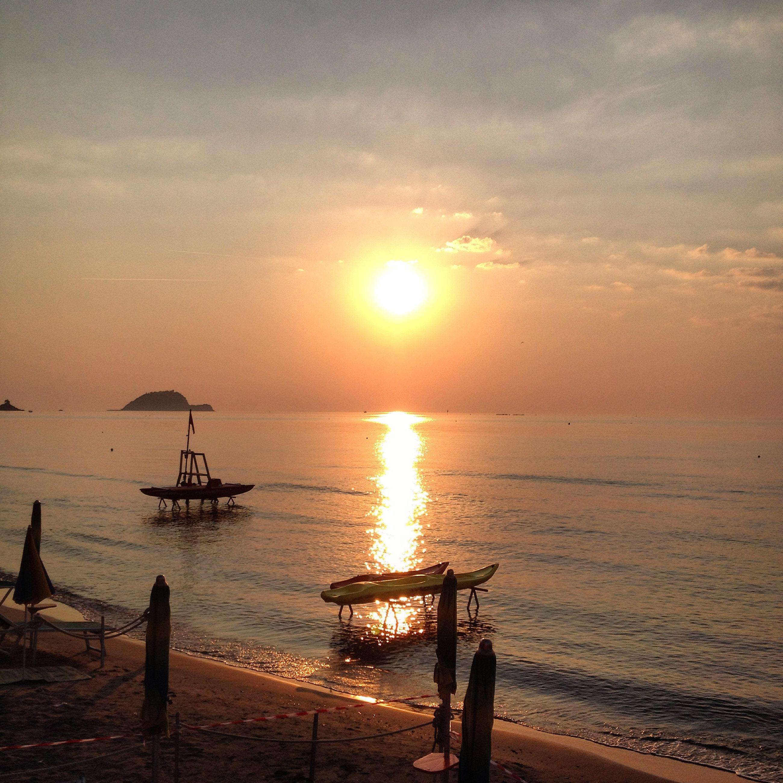 sunset, water, sea, sun, horizon over water, nautical vessel, transportation, scenics, sky, beauty in nature, tranquility, tranquil scene, orange color, boat, silhouette, mode of transport, nature, sunlight, idyllic, sunbeam