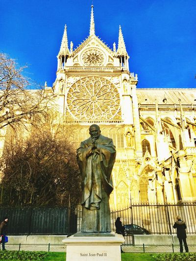JP II Saint John Paul Notre-Dame Notre Dame De Paris Statue Sculpture Human Representation Male Likeness Art And Craft Low Angle View Outdoors Built Structure Architecture Travel Destinations No People Clear Sky Day Building Exterior Tree Sky