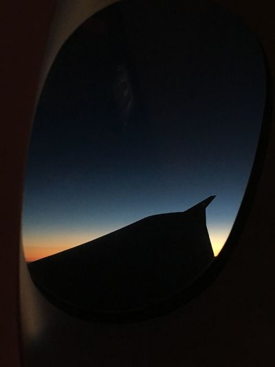 Silhouette Airplane The View Out Of My Window High Milage Shadow Shark Fin Sky Sunrise Silhouette Window View Abu Dhabi Emirates Business Class Landing UAE From The Plane Window