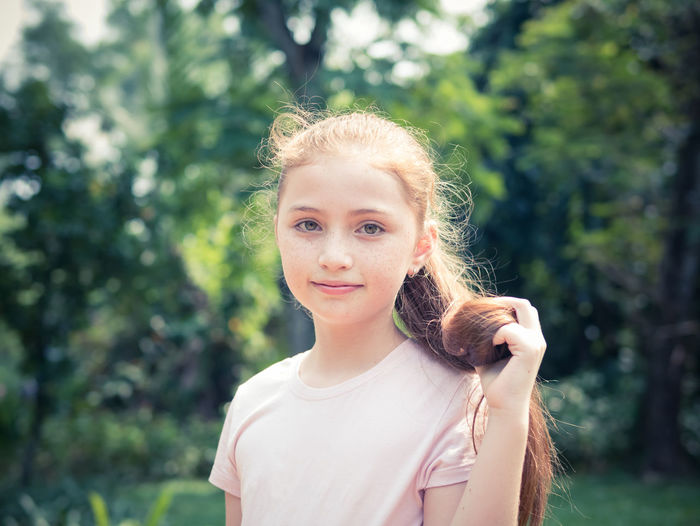 Portrait of beautiful little girl in the park on a sunny day Happy Pink Sunlight Sunny Adorable Beauty Blond Hair Caucasian Childhood Day Girl Kid Lifestyles Little Looking At Camera Lovely Nature One Person Outdoors Park Portrait Pretty Smile Tree Young Adult