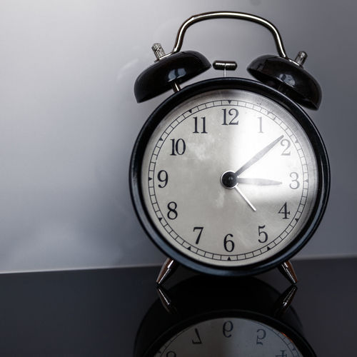 Close-Up Of Alarm Clock On Table