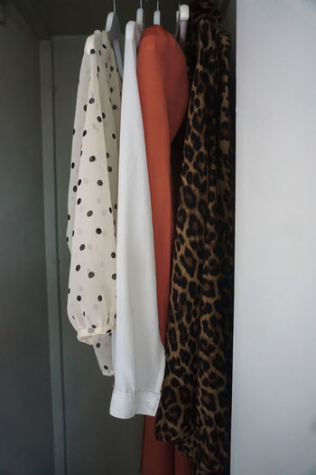 Midsection of clothes hanging on display at home