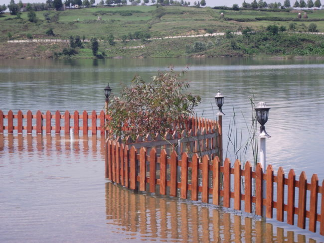 Barrier Beauty In Nature Boundary Day Fence Lake Landscape Nature No People Outdoors Plant Protection Reflection Safety Scenics - Nature Security Tranquil Scene Tranquility Water Wooden Post