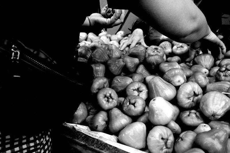 Midsection of person holding vegetables at market