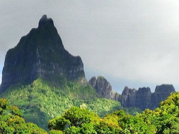 Beauty In Nature Cliff Day Fog Geology Landscape Moorea Mountain Mountain Range Nature No People Outdoors Physical Geography Rock - Object Rock Formation Scenics Sky Tranquil Scene Tranquility Travel Destinations Tree