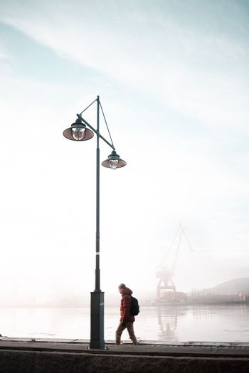 Fog Minimalism Sky Water Real People Sea One Person Nature Full Length Cloud - Sky Outdoors Beauty In Nature Day Men Crane - Construction Machinery