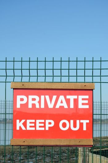 Private keep out sign on red background Text Western Script Communication Sign Fence Keep Out Private Keep Out Wire Outdoor Red Capital Letter Information Security