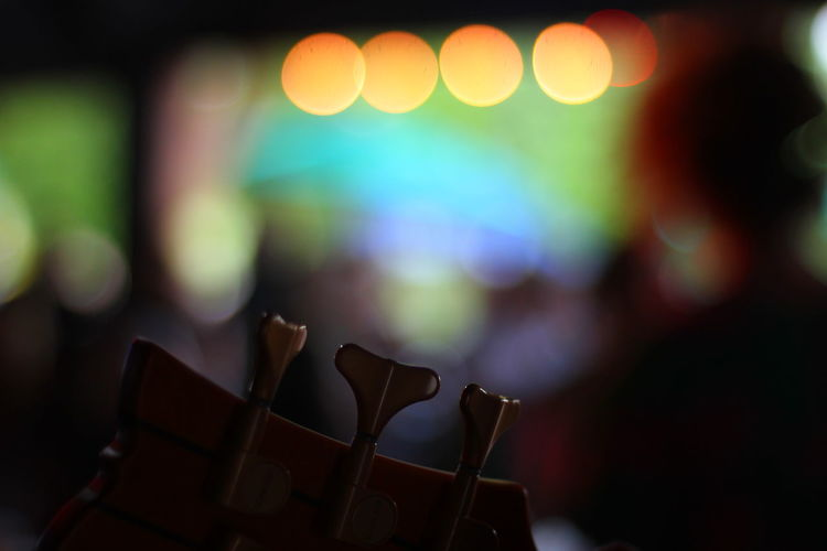 Close up of base guitar headstock with colorful background Funk On Fire Performance Stage Fun Matches Nightlife Night Life Excitement Colorful