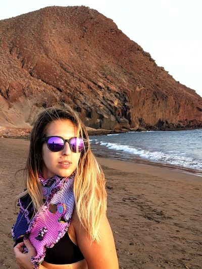 EyeEm Selects Sand Sunglasses Beach One Girl Only People Young Adult Girls Long Hair Vacations Portrait Young Women Desert Beauty Summer Purple One Person Knitting Crochet Scarf Tenerife Island Canary Islands Tenerife