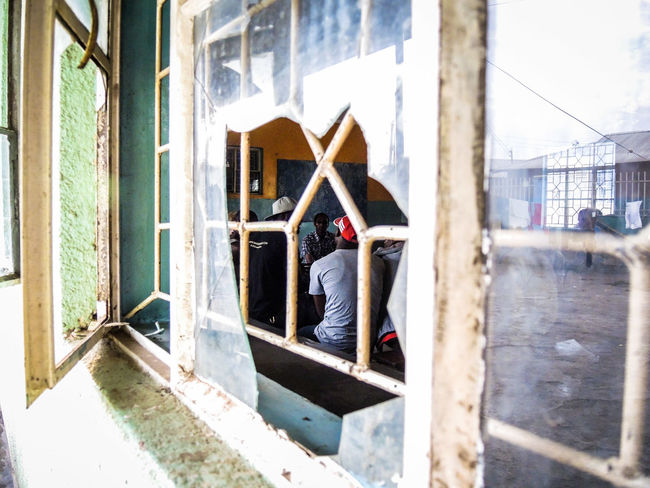 Orphanage in Arusha Architecture Building Exterior Built Structure City Cleaning Equipment Day Lifestyles Men One Person Orphan Orphanage Orphanage School Orphans Outdoors Paint Roller People Real People Window Window Washer Working