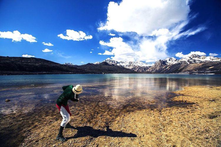 Full Length Of Man At Lake Against Sky