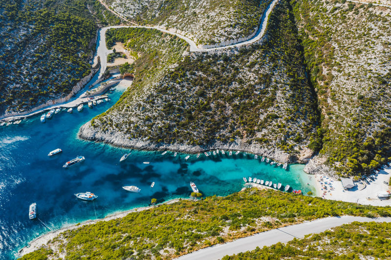 Aerial view of porto vromi with many fisher boats in the blue bay. zakynthos - zante island, greece
