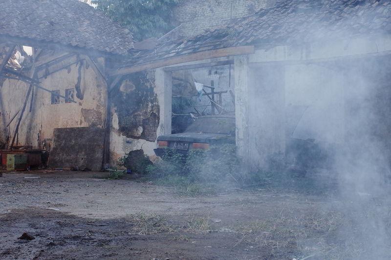 Smoke emitting from abandoned building