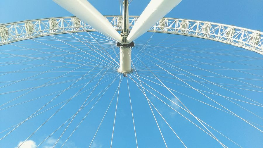 Low Angle View Of Millennium Wheel Against Blue Sky