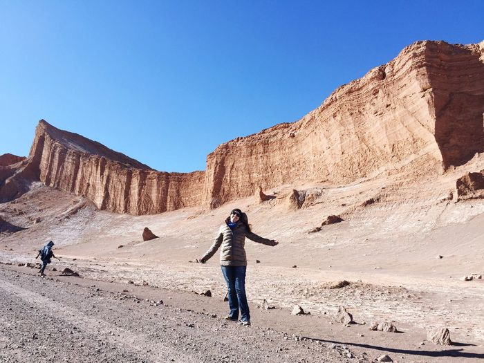 Woman standing at valle de la luna in atacama desert