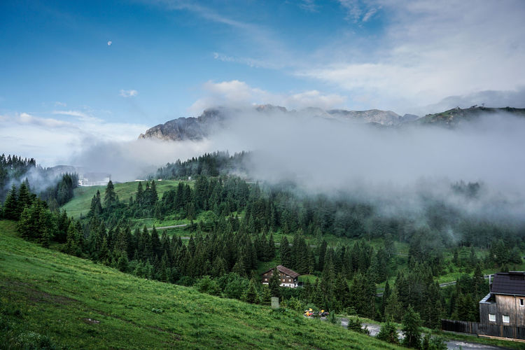 Scenic view of mountain cloudy landscape against clear sky.