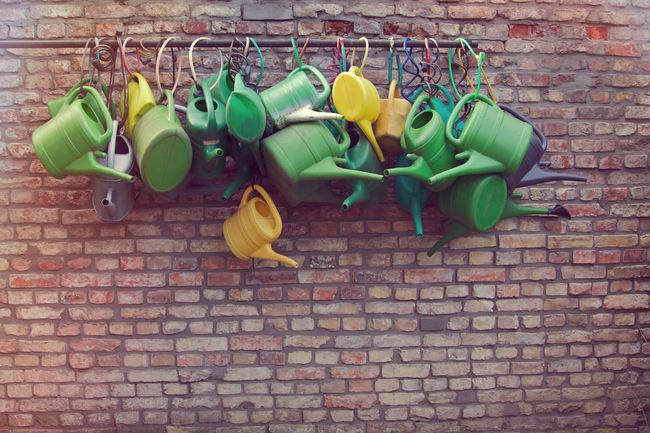 same same but different... Arrangement Beautifully Organized Brick Wall Cemetery Cemetery Photography Day Gardening Gardening Equipment Germany Green Color Hanging Large Group Of Objects Many Multi Colored No People Order Outdoors Plastic Same Same But Different Watering Can Yellow