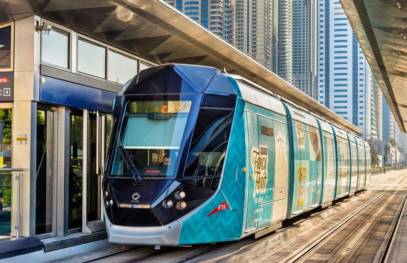 Train on railroad station platform in city