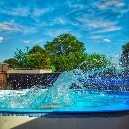 Splashing Big Splash Water Pool Pool Time Summer Blue Blue Sky Jump In The Pool Fun Home Is Where The Art Is Colour Of Life What's On The Roll Eyeemphoto Live For The Story Sommergefühle Summer Exploratorium Visual Creativity Summer Sports
