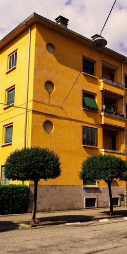 Architecture Building Exterior Built Structure Città Sociale City Day Low Angle View Memories ❤ No People Old House For Workers Outdoors Sky Tree Yellow