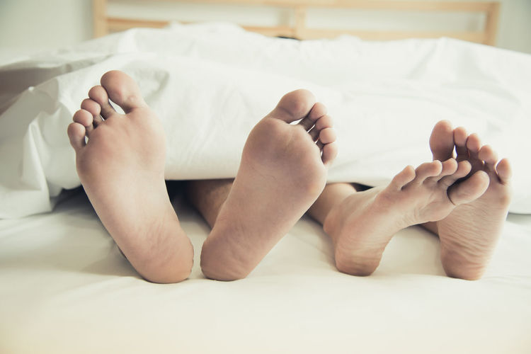 Couple Lover barefoot Bed Bedroom Close-up Comfortable Cozy Domestic Life Home Interior Human Body Part Human Foot Human Leg Indoors  Low Section Lying Down People Real People Relaxation Resting Sheet Sleeping Sole Of Foot Togetherness