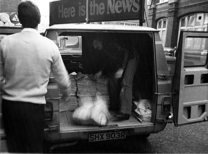 The final edition of the London Evening News being loaded into a delivery van - Northcliffe House, London Adult Adults Only Car Day Land Vehicle London Evening News Men Mode Of Transport Newspapars Newspaper Van Only Men Outdoors People Real People Rear View Text Transportation Two People EyeEmNewHere The World Before Bin Laden Postcode Postcards