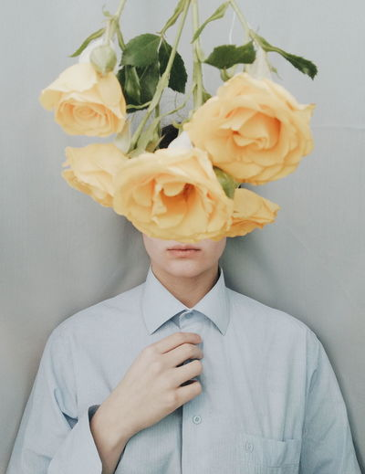 Midsection of man holding rose bouquet