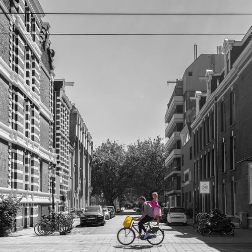 Architecture Transportation Built Structure Bicycle Mode Of Transport Building Exterior City Land Vehicle Men Riding Clear Sky Travel Street City Life Lifestyles On The Move Road Full Length Leisure Activity Cycling