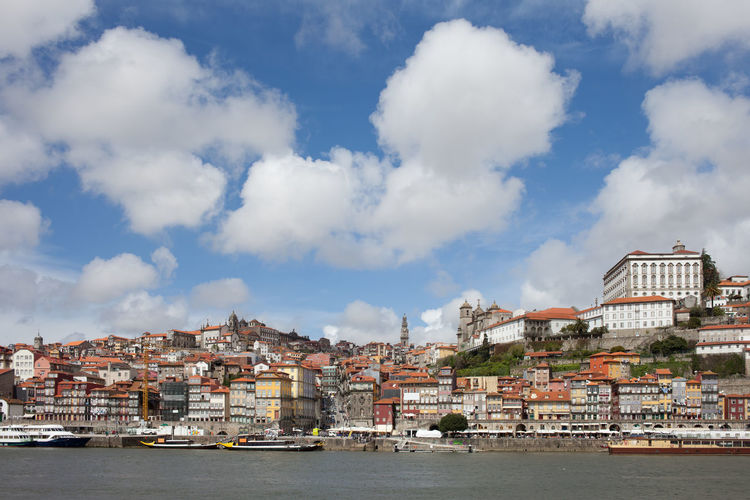 City skyline of Porto in Portugal, Old Town at Douro River Douro  Houses Old Town Porto Portugal Portuguese Skyline Travel Architecture Building Exterior Buildings Built Structure City Cityscape Europe River Travel Destinations Urban Urban Landscape Urban Skyline Water Waterfront