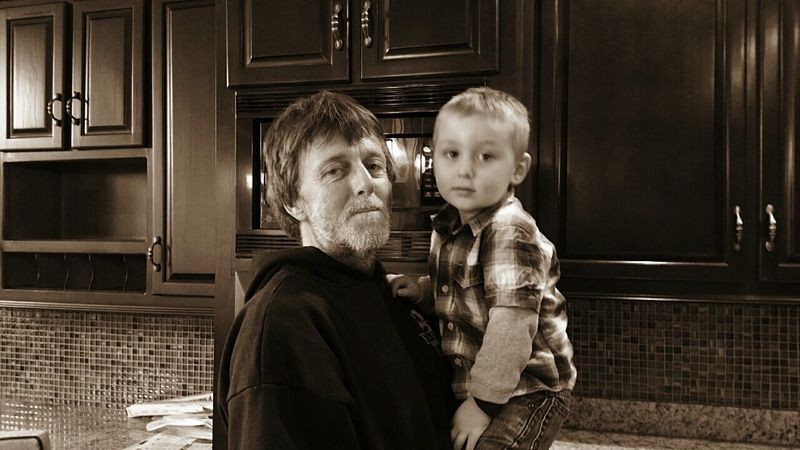 People Portrait Of America Family Love Indoors  Childhood Bonding Boy Happiness Friendship Adult Child Boys Males  Togetherness Lifestyles Domestic LifeHome Interior Desaturated Vintage Sepia Brown Grandpa Grandson Grandchild