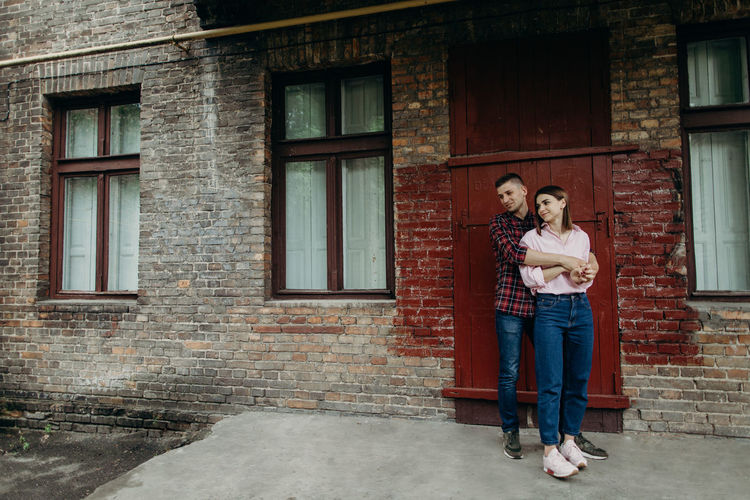 Full length of couple standing on footpath