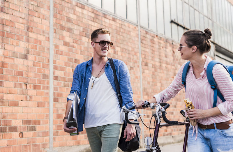 Young couple on bicycle in city