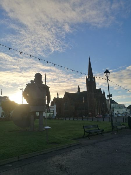 Largs, Viking town in Scotland Architecture History Business Finance And Industry Cloud - Sky Building Exterior Religion Built Structure Sky Outdoors Day Grass No People