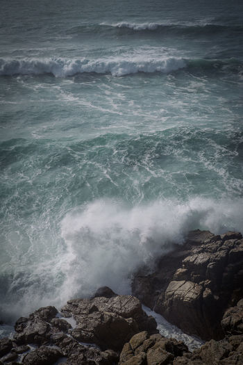 Waves crash against the shoreline off the coast at Lands End in Cornwall, United Kingdom. Beauty In Nature Breaking Coastline Cornwall Idyllic Motion Nature No People Outdoors Power In Nature Remote Rock - Object Scenics Sea Seascape Shore Splashing Tranquility Water Wave