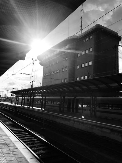 Rail Transportation Railroad Track Sunlight Track Sunbeam Architecture Sky Travel Railroad Station Platform Public Transportation Day No People Lens Flare Railroad Station Sun Building Exterior Mode Of Transportation Transportation Built Structure