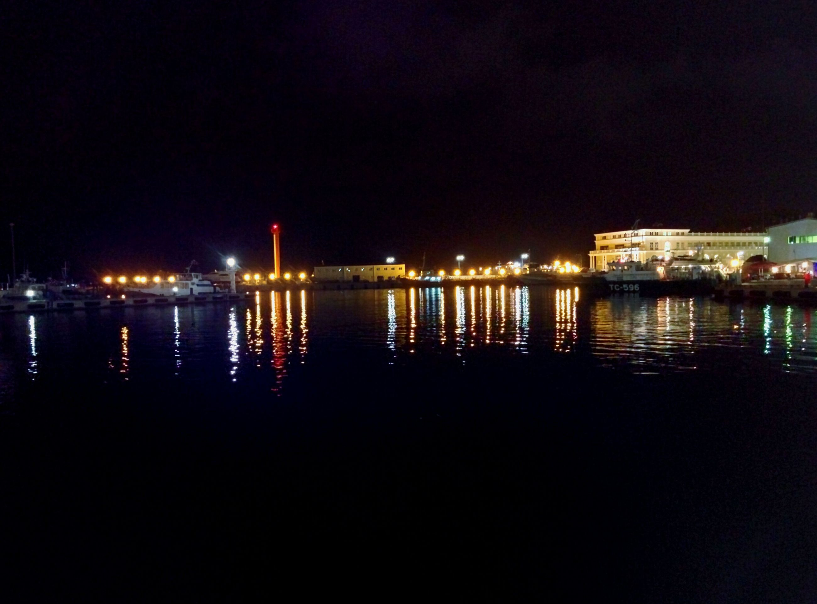 illuminated, night, water, reflection, waterfront, built structure, architecture, river, building exterior, city, sea, copy space, clear sky, sky, lake, mid distance, dark, nautical vessel, outdoors, no people