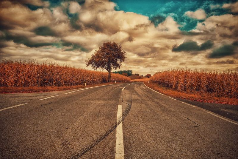 On the road again..... The Way Forward Cloud - Sky Outdoors No People Nature Scenics Beauty In Nature Tranquil Scene Landscape Road Austria Melancholic Landscapes Fuji Xpro2 Capture The Moment Landscape_photography Tire Tracks