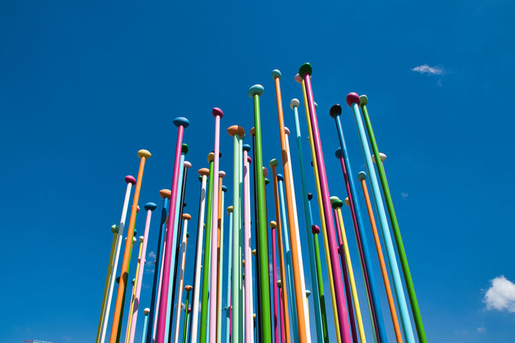 Coloris installation a representation of a world map, which stand about 100 pastel-color metal poles