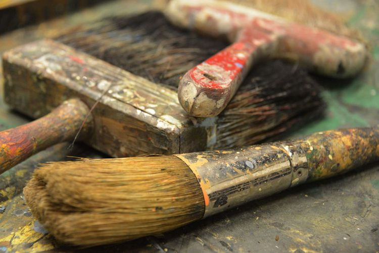 High angle view of paintbrushes in container on table