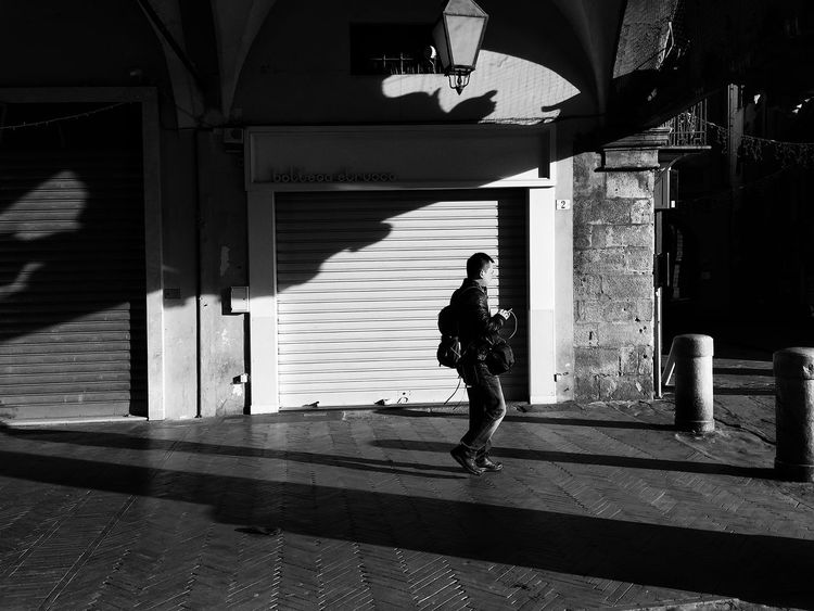 Fellow Photographer ... B&w Street Photography Showcase: December Light And Shadow Leading Lines Perspective Streetphotography Pisa Italy