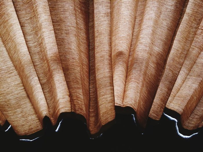 High angle view of brown curtain on table