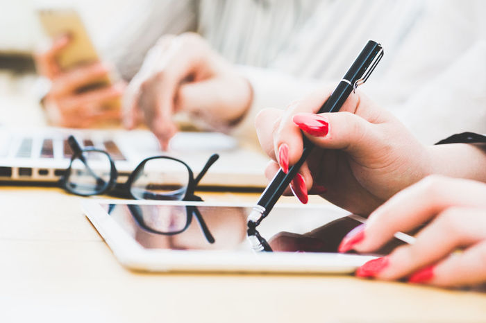 Small Business Office Team People Working Desk Technology Together Women Female Pen One Person Hand Close-up Selective Focus Human Finger Fingernail Table Manicure Nail Writing Finger