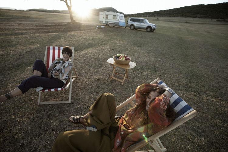 People relaxing on field